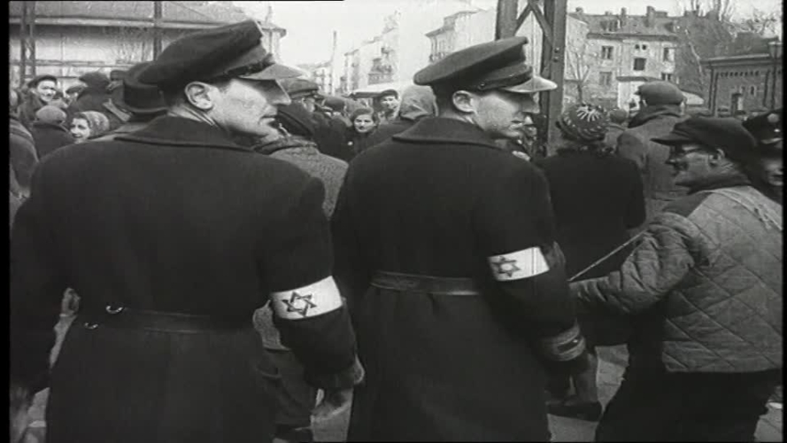 914738677-jewish-ghetto-police-warsaw-ghetto-violation-of-human-rights-arresting-889x500.jpg